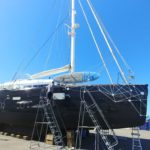 Vinyl Boat Wrap Installation On a Catamaran